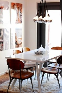 Crate & Barrel Ypsilon dining table $449 combined with Shelby Williams Impala chairs. Also that Nuevo Living Ten Tales chandelier. Love it!