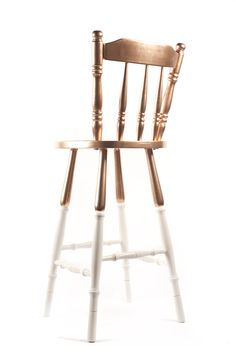 Upcycled bar stool - part golden and part white.