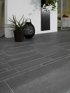 dark charcoal colored porcelain tiles as a contrast to the interior flooring and warming up the U Outdoor Stairs, Outdoor Balcony, Outdoor Tiles, Outdoor Flooring, Balcony Tiles, Balcony Flooring, Front Garden Landscape, Landscape Design, Exterior Tiles