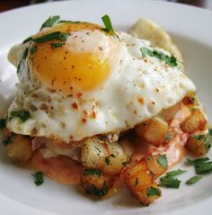 Recipe For Potatoes with Fried Eggs and a Roasted Pepper Aiola - Huevos Estrellados - A rich golden brown and crispy potatoes to accompany fried eggs.