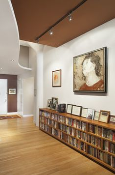 Nice low and long bookcase -Loft Entry - contemporary - entry - new york - Prestige Custom Building & Construction, Inc.