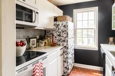 Kerra Michele Huerta's small rental galley kitchen -- black chalkboard paint walls, removable tempaper wallpaper on fridge and backsplash -- Apt Envy  See more images from you really CAN love a rental on domino.com  See more images from you really CAN love a rental on domino.com