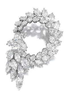 DIAMOND BROOCH, 1960S.  Of openwork swirl and spray design set with brilliant-cut, marquise- and pear-shaped diamonds, mounted in platinum,  maker's marks for Jacques Timey.