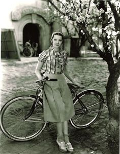 Sylvia Sidney couldn't have been dressed lovelier to ride on her bike.