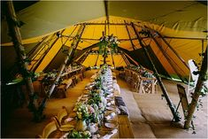 The Flower Filled, Vintage Wedding of Zoe & Ben...Tipi back garden reception filled to the brim with fabulous plants and floral arrangements, finished off with vintage touches and personal details. Photos by Kevin Belson.