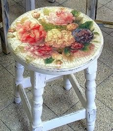decoupaged stool.  I would like to use the colors in my Birds & Blooms magazines to do this with #painted #furniture