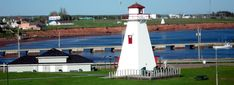 Lighthouse on PEI. The coasts of Prince Edward Island feature red cliffs, dunes, and sandy beaches. There are two ways to get to this idyllic island: a ferry from Nova Scotia or the Confederation Bridge from New Brunswick. Trans Canada Highway, Green Fields, Prince Edward Island, Anne Of Green Gables, New Brunswick, The Province, Sandy Beaches, Nova Scotia, Wood Islands