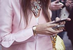 Pink + Stack up them Cartier bangles.