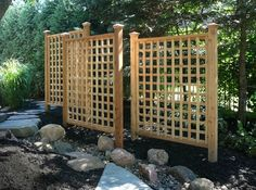 A trellis not only adds beauty to your landscape but function as well. This grouping provides a private and intimate space. We offer custom Cedar Trellis and Pergola design, construction and installat (Diy Garden Pergola) Garden Privacy, Privacy Landscaping, Backyard Privacy, Privacy Trellis, Trellis Fence, Pool Fence, Outdoor Privacy Screens, Corner Landscaping, Trellis Panels