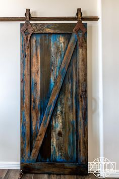 """A beautiful sliding """"Z"""" style barn door with our """"ignite finish"""" and antique style custom hardware."""
