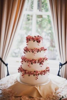 wedding cake with flowers on each tier