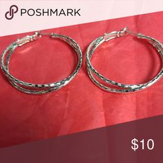 """Charming Charming Large Hoop Earrings 1.5 """" textured silver earrings. Worn one time. Would pair nicely with necklace listed separately.  Offers Welcome! Charming Charlie Jewelry Earrings"""