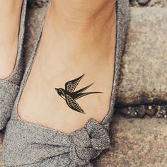 Cute Black Swallow Tattoo on Girl Foot
