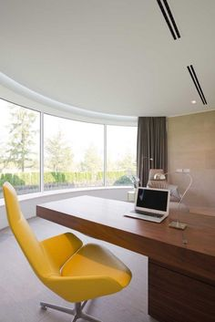Modern Home Office // minimal and classic wood desk with a pop of color with this bright yellow office chair at the Villa in Agalarov Estate, near Moscow, Russia by SL*Project