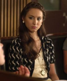 Her clothes are so vintage chic. I love how she paired this shirt with the busy shrug and clock necklace