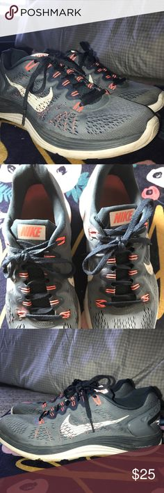 NIKE tennis shoes Barely worn NIKE tennis shoes. Coral and grey colors. Shoes are not broken in yet. Size 9 Nike Shoes Athletic Shoes