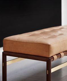 Solid American Walnut teamed with top stitched natural Verona aniline leather imparts contemporary handmade luxury, the design sitting comfortably in both contemporary and classic interiors.
