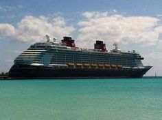 The new Disney Cruise Line ship the Disney Fantasy makes its first ever stop at the line's private Bahamas resort Castaway Cay on its way to Port Canaveral.
