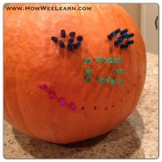 Clean out inside of pumpkin.  Drill small holes in a pattern first so that the pumpkin is pierced all the way through.  Then have kids go back and put the light bright pieces in the holes.  Add a light inside and voila!  Light Bright Pumpkin!