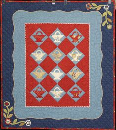 """""""A Tisket, A Tasket"""" made and quilted by Ann Swanson.  Judges Choice Award.  Boise Basin Quilters' Guild 2015 show."""