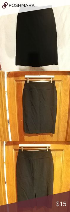 Great black pencil skirt! Knee length with a faux slit in the back Paniz Skirts Pencil