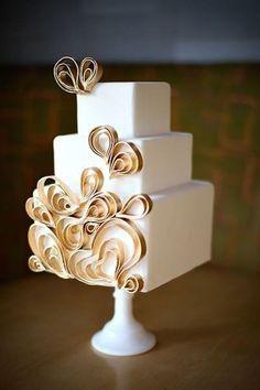This cake is truly art! Love the contemporary gold heart designs - almost too pretty to cut into!