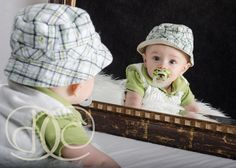 Boy 6 Months in Mirror.  Credit: J. Dates