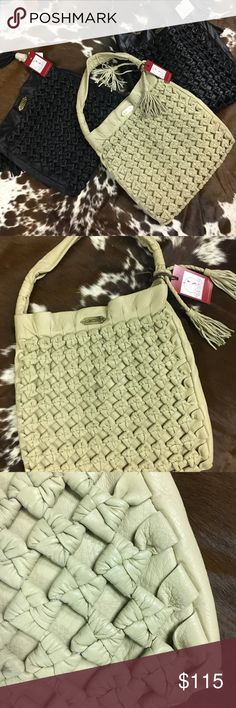 A.Che' Los Angeles Designer leather bag Handmade in Thailand the leather is incredibly soft. An iPad fits in this bag for the working woman who Durant want a huge bag. It's roomie and looks fashionable! Not over beating! It's dimply the perfect bag! a.che' Los Angeles Bags Hobos