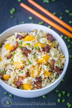 We love this bacon mango fried rice! The mango caramelizes with the crisp bacon – so good! 3 ingredients, 1 pan, 15 min | natashaskitchen.com