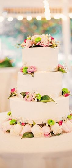 white weding cake with pink flowers