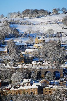 Village in the snow by Andrew Kearton. Broadbottom in Cheshire, England, love the tiered houss
