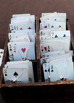 Use playing cards for storing or displaying jewelry