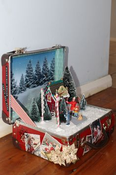 More Christmas craft. Altered upcycled child's suitcase lunch pail. Suit case. Christmas winter scene. Lemax figurines and trees. Tim Holtz snowflake stencil.