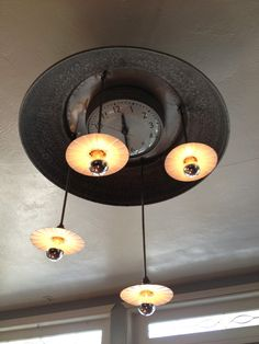 We just made this clock ceiling light for a restaurant in Sacramento for Johnson & Ross Design.