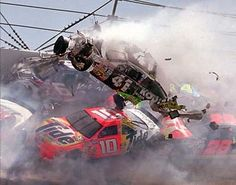 "Talladega wreck, prob 1990-1992; #10 Tide car is Darrell Waltrip, #6 Vavoline car is Mark Martin, #28 TEXACO car is Davey Allison. Not sure who ""airborne"" car is without research, lol! But I was there  remember...those were the days of Nascar racing greats  my favorite memories with my Daddy!"