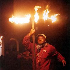 Mardi Gras flambeau carrier, NOLA...  Hard to believe they did this but they were the best part of the night parades.