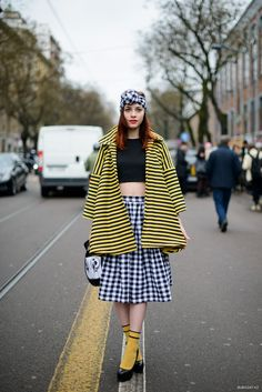 Gingham skirt and matching head wrap and a horizontal stripe coat. #MFW
