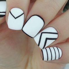 You can never go wrong with black and white. This design creates a mix and match pattern of monochrome nails.