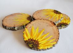 These beautiful hand painted wooden coasters in a bright sunflower design will brighten up your home and believe me, you will fall in love with them  All five designs are nearly the same on each coaster and the natural wood slices have their textured bark which gives them a very rustic look.  these sunflowers have been individually painted (and NOT screen printed) with the natural wooden texture as background to give it a shabby chic look!  They have been given a double coating of a…