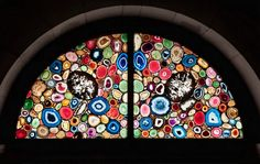 Sigmar Polke's stained glass windows in Germany's Grossmunster Cathedral in Zurich. They're made with slices of real agate - it would certainly be stunning in person!