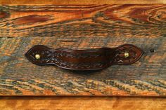 Tooled leather drawer pull
