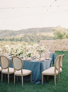 Linens: http://latavolalinen.com | Photographer: http://www.kurtboomer.com/ | Florals: http://kellykaufmandesign.com | Read More: https://www.stylemepretty.com/2017/10/09/french-blue-inspired-winery-wedding/