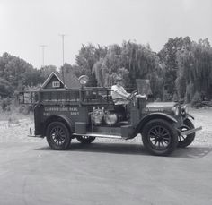 """In 1955, this Clarkson-Lorne Park fire reel — a 1924 Reo Speed wagon— run by the Clarkson-Lorne Park Fire Department was """"one of the oldest around"""". Clarkson and Lorne Park are now neighbourhoods in Mississauga. This picture was taken on the Lakeshore Road (Clarkson)."""
