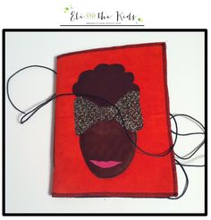 Soft covered Journal/Notebook, bright coral/red faux suede outer cover with leather made natural hair female's silhouette on front cover and white heavy echo friendly paper on the inside held shut with black leather string. Material of the bow is a decorative gold fabric.   Approx. Measurements...