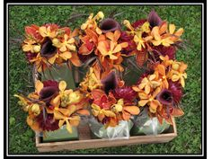 bouquets included burgundy callas, orange orchids & burgundy dahlias