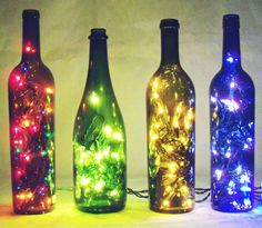 collect desired amount and coloured empty bottles buy new or get your old christmas lights insert christmas lights in he bottles