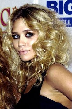 volume & curls & love the Smokey eyes ~ this would be hot for a Disco themed party