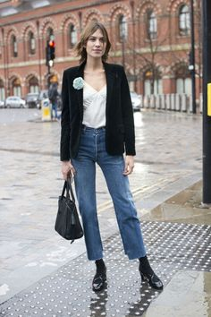 Alexa Chung wears Vetements deconstructed jeans, a white cami, black blazer, and black heeled pumps. Blazer Jeans, Blazer Outfit, Star Fashion, Girl Fashion, Fashion Outfits, Fashion Weeks, Fashion Women, Alexa Chung Style, Cool Girl Style
