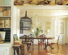"The bedroom and dining room in ""The house on the hill,"" featured in India Hick's first book, Island Life: Inspirational Interiors, offers a more decorated version of plantation or colonial style, but still has an airy, sunny ambiance."