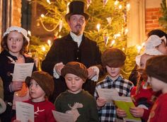 Our Victorian Guide leads the carol singing at the York Castle Museum 'Victorian Christmas Experience', 2014.